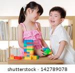 asian kids piling up building... | Shutterstock . vector #142789078