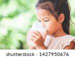 cute asian child girl is... | Shutterstock . vector #1427950676