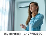 Small photo of Sad upset woman caught a cold from the air conditioner and suffering from sore throat