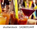 colorful drinks on bar closeup | Shutterstock . vector #1428051449