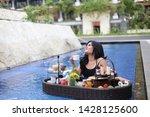 women drinking tea breakfast in ... | Shutterstock . vector #1428125600