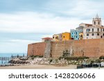View from the beach on wall and buildings in Termoli city, Italy