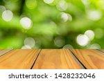 empty wood floor with blurred... | Shutterstock . vector #1428232046