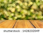 empty wood surface with blurred ... | Shutterstock . vector #1428232049