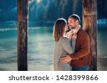 a couple in love at braies lake ... | Shutterstock . vector #1428399866