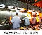 Chef In Restaurant Kitchen At...