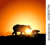 Wild Bears Silhouetted Against...