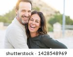 Stock photo romantic couple smiling and cuddling on a sunny day 1428548969