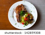 pork chop with salad on table... | Shutterstock . vector #142859308