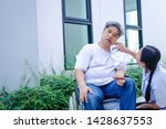 Small photo of Asian guy, white hair, sick, paralyzed, unable to walk, must sit on a wheelchair Have a wife to look after