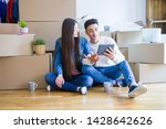 young asian couple sitting on... | Shutterstock . vector #1428642626