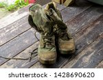 old war boots are on the boards | Shutterstock . vector #1428690620