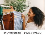 smiling fashion buyer choose... | Shutterstock . vector #1428749630