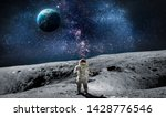 Small photo of Moon surface with astronaut on it. Planet Earth on the background. Apollo space program. Elements of this image furnished by NASA.
