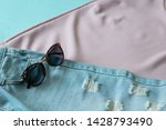 sunglasses on ripped jeans and... | Shutterstock . vector #1428793490
