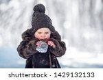 little cute boy is eating a... | Shutterstock . vector #1429132133