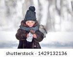 little cute boy is eating a... | Shutterstock . vector #1429132136