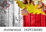 malta flag on autumn wooden... | Shutterstock . vector #1429136060
