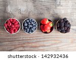 a four bowls overflowing with... | Shutterstock . vector #142932436