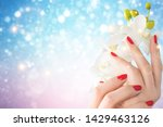 orchid flowers in female hands... | Shutterstock . vector #1429463126