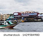Small photo of Wang Lang Pier,BANGKOK THAILAND-08 JUNE 2019:Prannok Pier,also known as the Siriraj Pier or Wang Lang Pier with designated pier number N10, is a pier on the Chao Phraya River.
