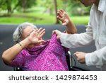 Small photo of Asian elderly woman were physically abused ,attacking in outdoor park,angry young woman raised punishment fist,stop physical abuse senior people,caregiver,family stop violence and aggression concept