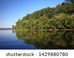 a landscape of a lake and trees.... | Shutterstock . vector #1429880780