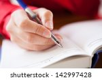 close up  of hand holding pen... | Shutterstock . vector #142997428