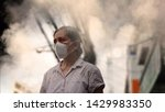 Small photo of Old woman wearing mask against air pollution (PM2.5) in the city. PM2.5 caused health problem and respiratory system disorder as lung cancer, allergy, asthma, chronic obstructive lung disease(COPD).