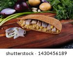 Stock photo marinated herring with potatoes in rye pita on a wooden board 1430456189