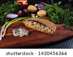 Stock photo marinated herring with potatoes in rye pita on a wooden board 1430456366
