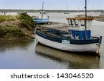 old wooden fishing boat on mud... | Shutterstock . vector #143046520