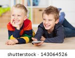Happy Brothers With Remote...