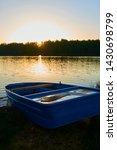 fishing boat in a calm lake... | Shutterstock . vector #1430698799