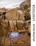 jellyfish stranded on the rocks ... | Shutterstock . vector #143070328