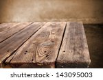empty space on old wooden table | Shutterstock . vector #143095003