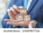Small photo of Code of conduct business concept on wooden blocks in businessman hands. Ethics and respect in working collective.