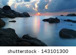 dramatic sunset in rocky beach  ... | Shutterstock . vector #143101300