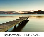 boat dock on shore of mountain... | Shutterstock . vector #143127643