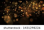 Golden Particles Hang In The...