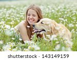 Stock photo beautiful woman playing with her dog outdoor portrait series 143149159