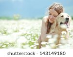 Stock photo beautiful woman playing with her dog outdoor portrait series 143149180