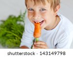 a child with a vegetable | Shutterstock . vector #143149798