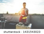 Young Man Cooking Meat On...