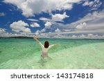 woman swiming at the beach | Shutterstock . vector #143174818