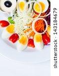 boiled egg salad on the white...   Shutterstock . vector #143184679