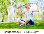 girl in the park sitting on the ... | Shutterstock . vector #143188894