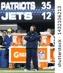 Small photo of EAST RUTHERFORD, NJ - NOV 22: New England Patriots head coach Bill Belichick stands on the sidelines against the New York Jets at MetLife Stadium on November 22, 2012 in East Rutherford, New Jersey.