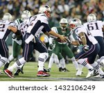 Small photo of EAST RUTHERFORD, NJ - NOV 22: New England Patriots quarterback Tom Brady (12) hands the ball off to defensive back Nate Ebner (43) at MetLife Stadium on November 22, 2012.
