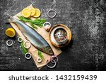 Stock photo salted herring on paper with spices onions and lemon on dark rustic background 1432159439
